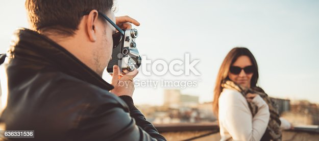 636330566istockphoto Man taking picture with camera 636331536
