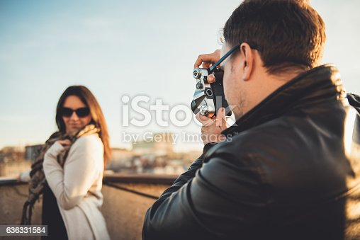 636330566istockphoto Man taking picture with camera 636331584