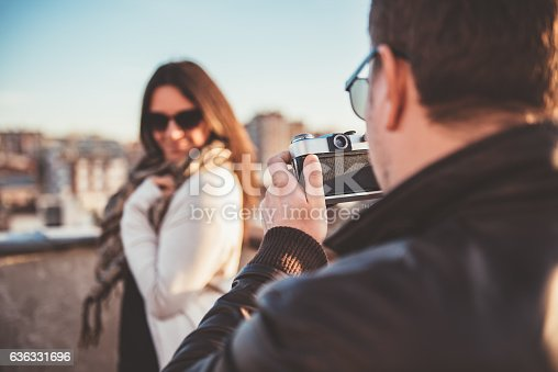636330566istockphoto Man taking picture with camera 636331696
