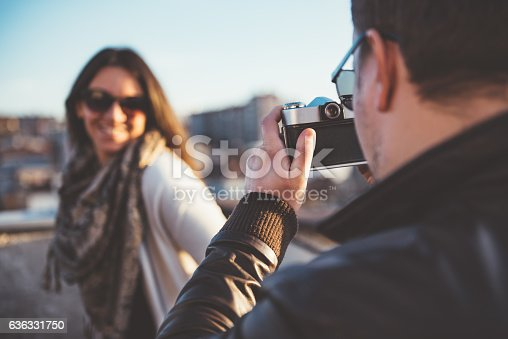 636330566istockphoto Man taking picture with camera 636331750