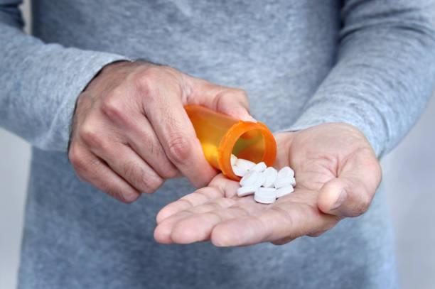 Man taking pills stock photo