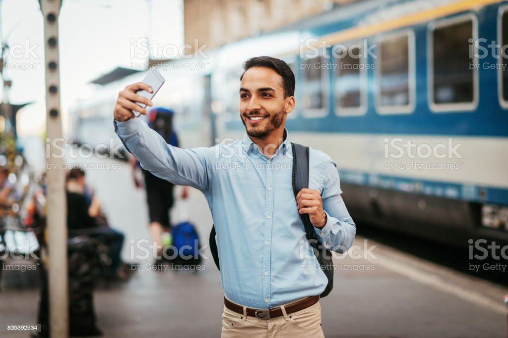 Man taking selfie before depart by train stock photo