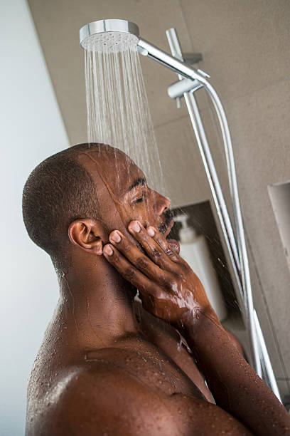 Man Taking Shower stock photo