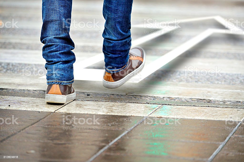 Man taking the step in the right direction stock photo