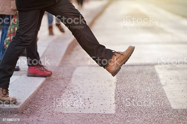 Man Taking The Step Stock Photo - Download Image Now