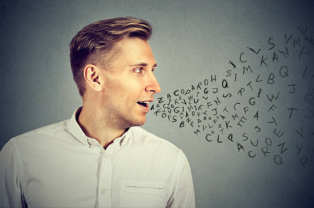 mann spricht alphabet buchstaben aus seinem mund - schöne englische wörter stock-fotos und bilder