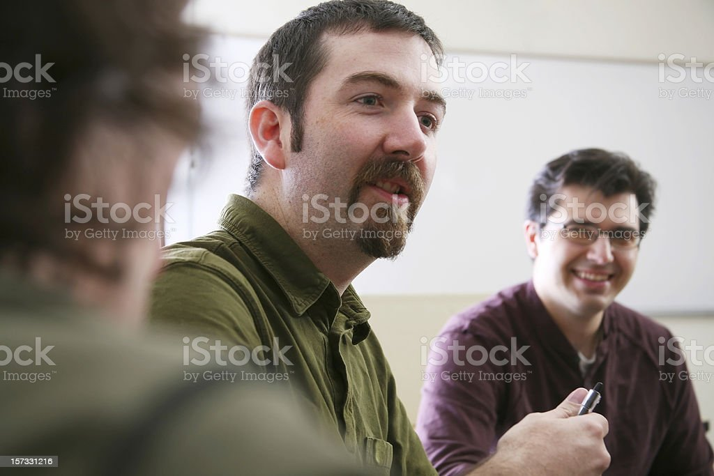 Man talking among other adults royalty-free stock photo