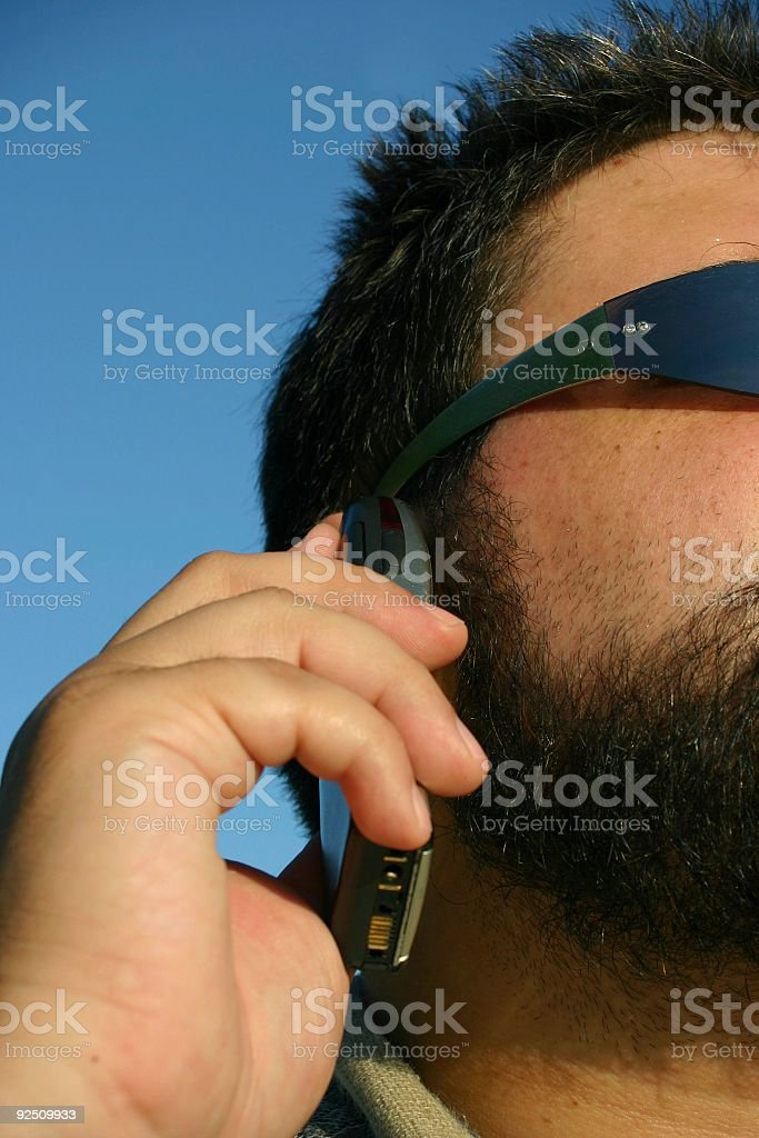 Man talking at a cellphone - half portrait royalty-free stock photo