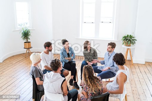 istock Man talking in group therapy session 923258802