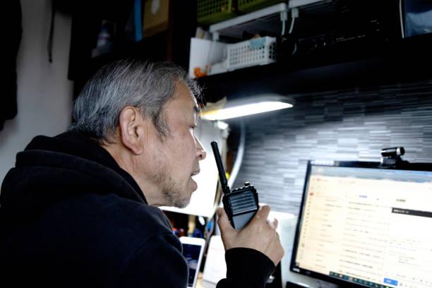 Man talking on handy radio stock photo