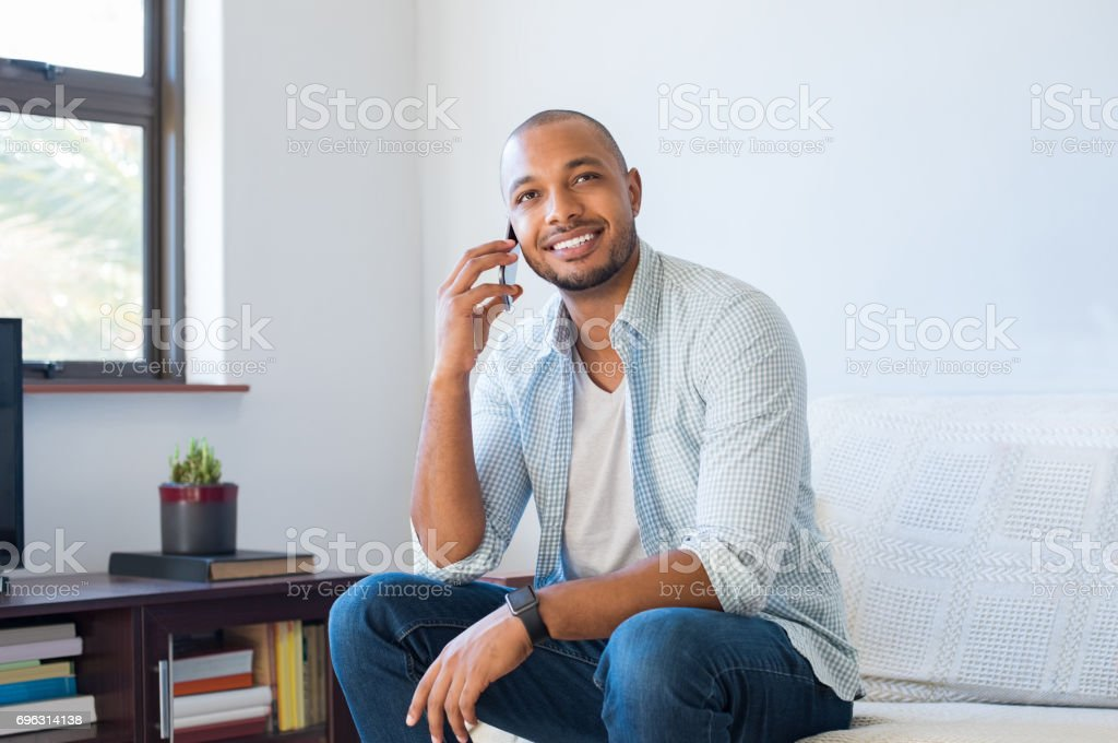 Man talking on mobile phone stock photo