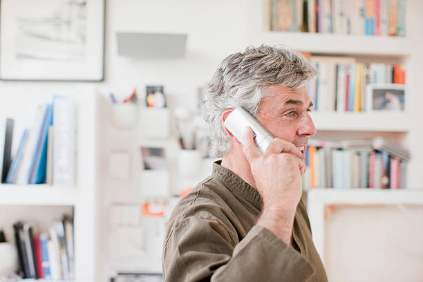 Man talking on telephone in office  cordless phone stock pictures, royalty-free photos & images