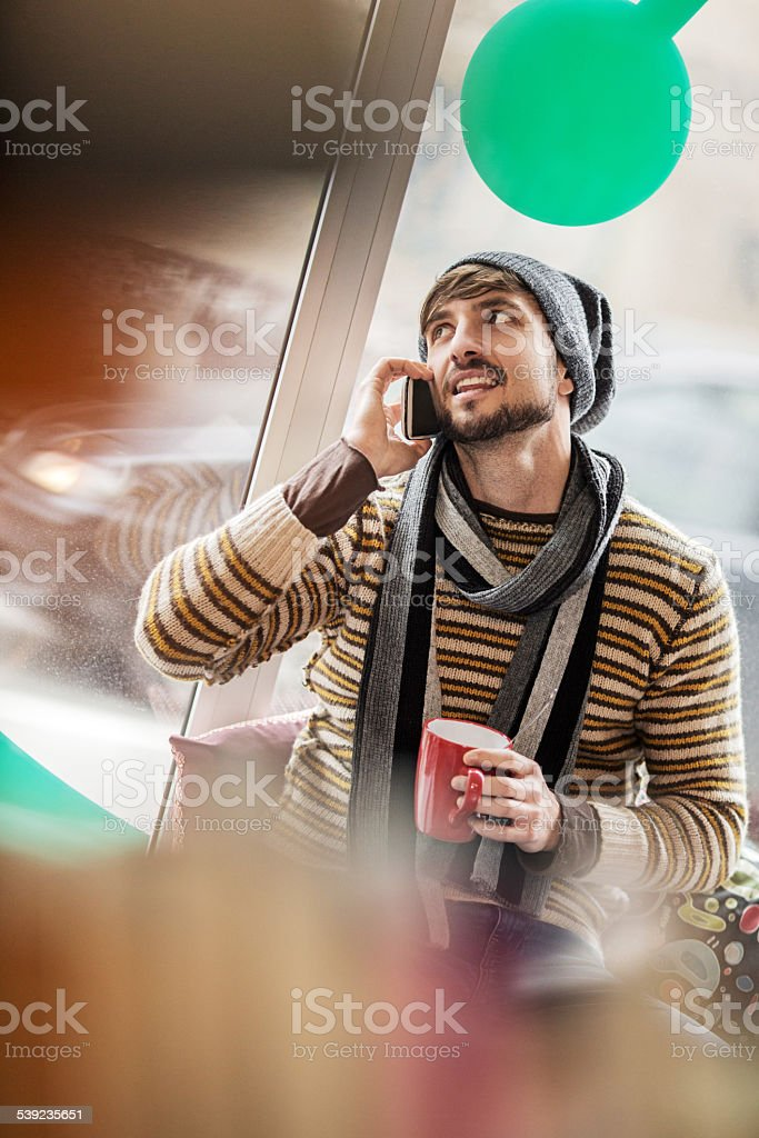 Man talking on the phone in a cafe. royalty-free stock photo