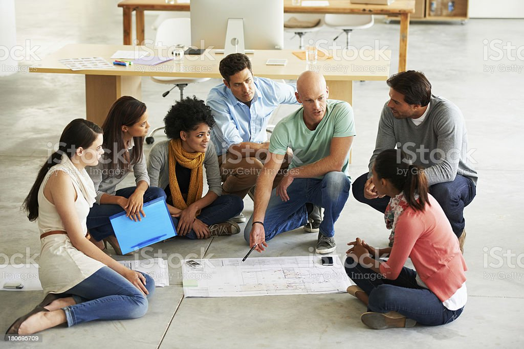 Man talking to a group of colleagues royalty-free stock photo
