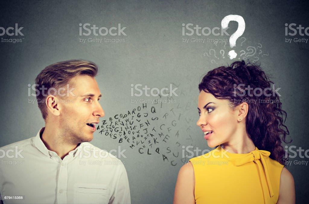 Man talking to an attractive woman with question mark - Photo
