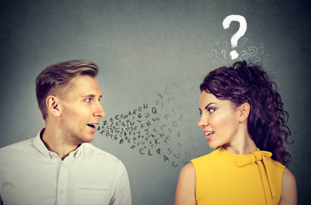 man talking to an attractive woman with question mark - orthographic symbol stock pictures, royalty-free photos & images