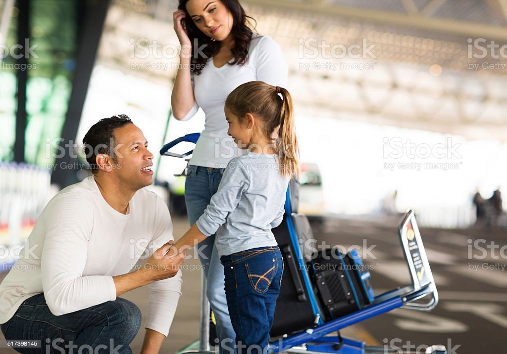 man talking to her daughter at airport before departure stock photo