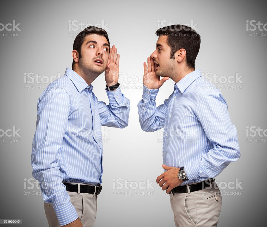 Man talking to himself stock photo