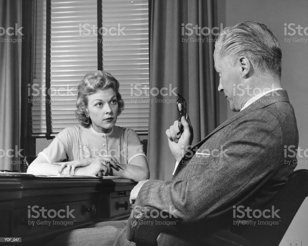 Man talking to woman who is taking notes 免版稅 stock photo