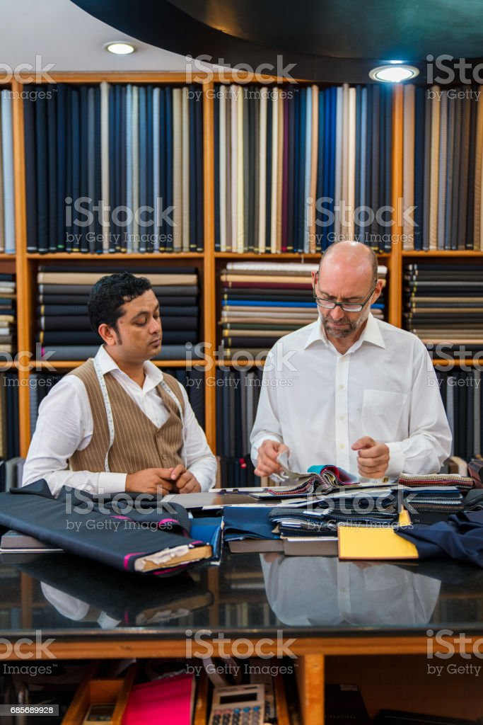 Man talking with a custom suit tailor royalty-free stock photo