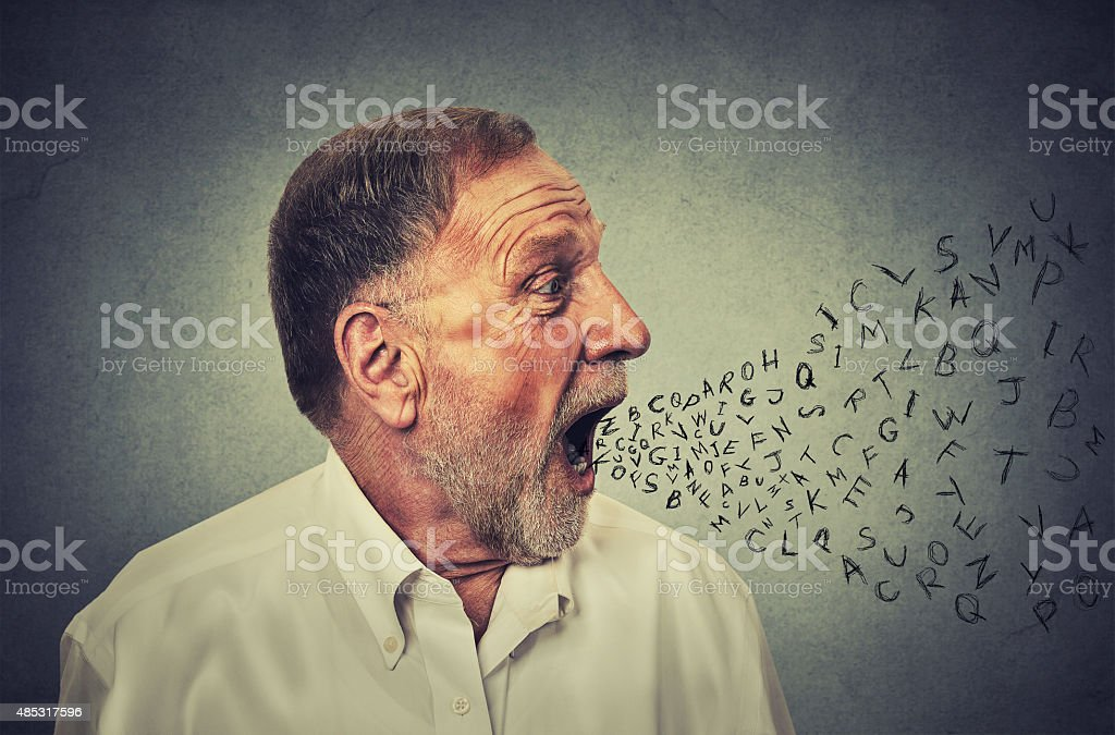 Man talking with alphabet letters coming out of mouth stock photo