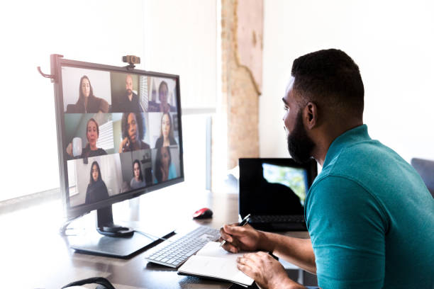 Man talking with colleagues during video call stock photo