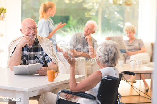 istock Man talking with disabled woman 905476860