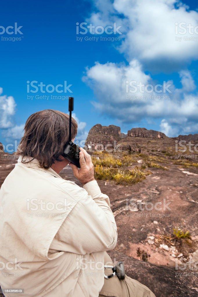 Man talking with satellite phone stock photo