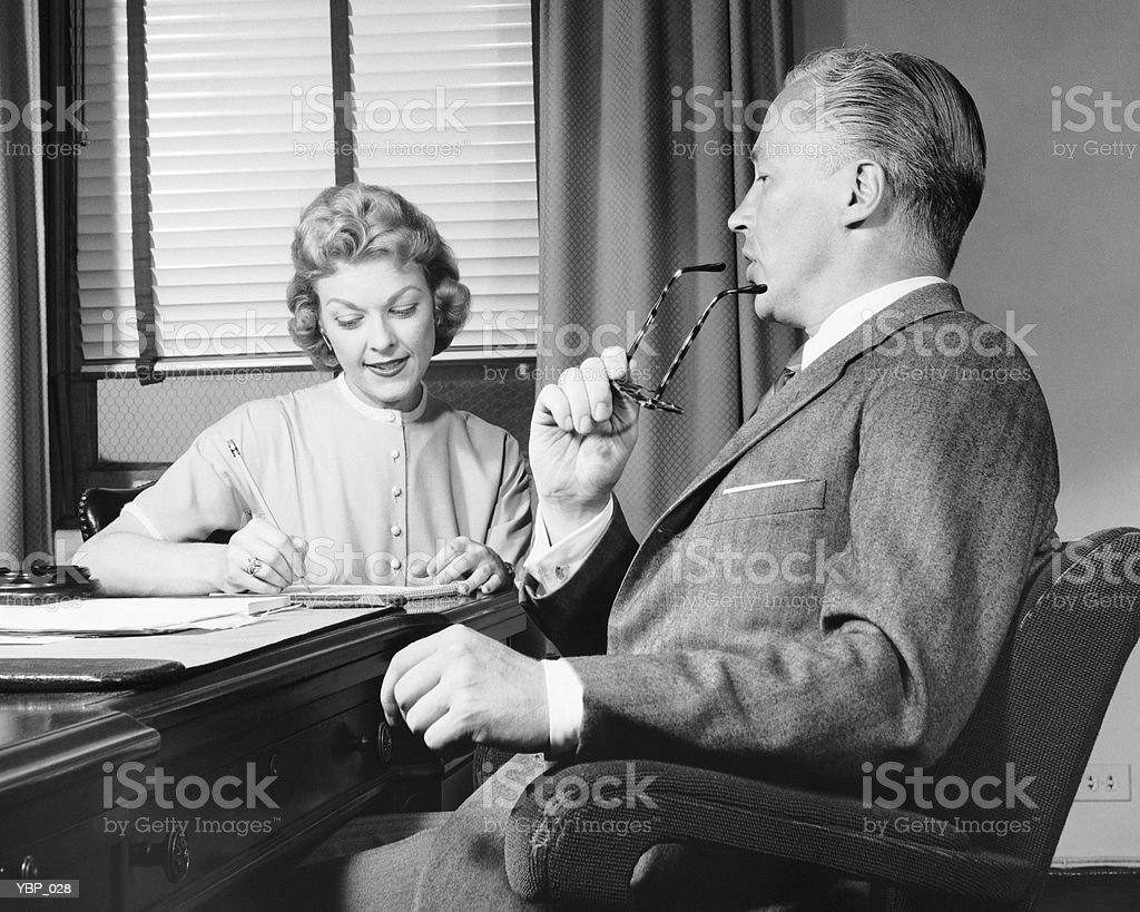 Man talking, woman taking notes royalty-free stock photo