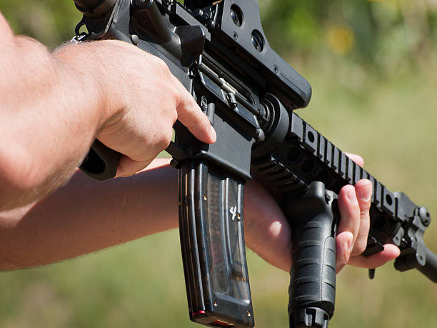 A man target shooting at a gun range Firearm AR-15 for target shooting. ar 15 stock pictures, royalty-free photos & images