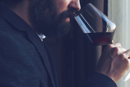 istock man tasting a glass of red wine 640133392