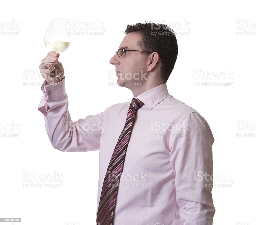 Man tasting a glass of white wine royalty-free stock photo