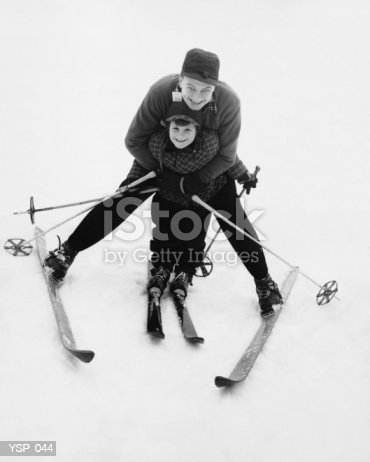 Man Teaching Boy To Ski Stock Photo & More Pictures of Black And White