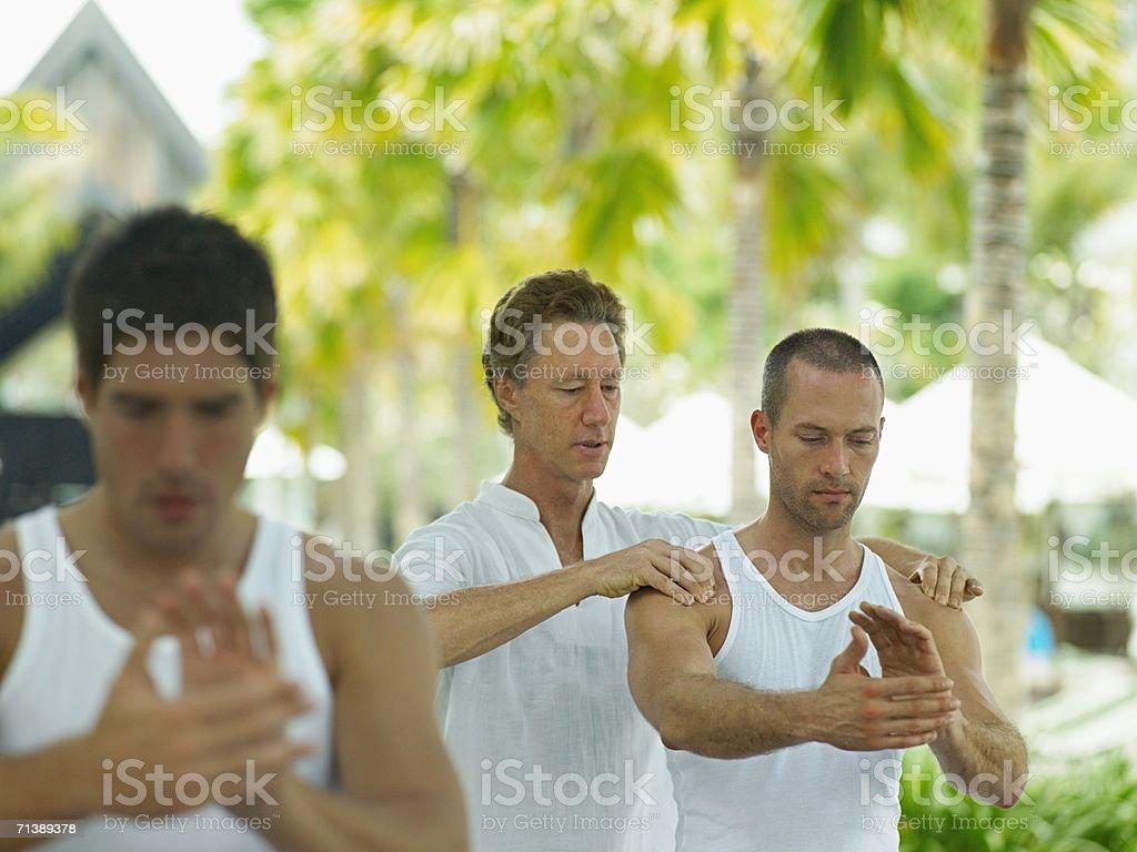 Man teaching tai chi royalty-free stock photo