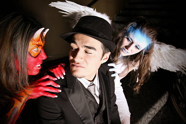 Man Tempted By A Shedevil And An Angel Stock Photo More Pictures Of Adult