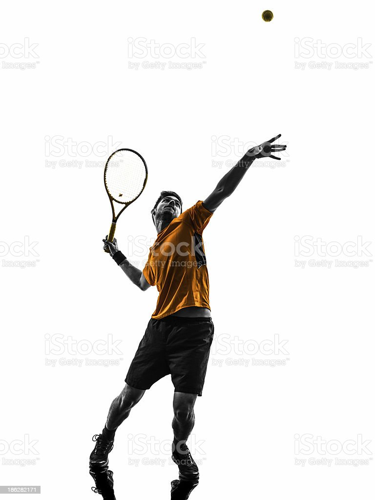 man tennis player at service serving silhouette stock photo