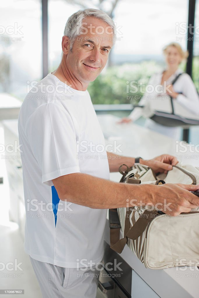 Man tennis racquet in gym bag royalty-free stock photo