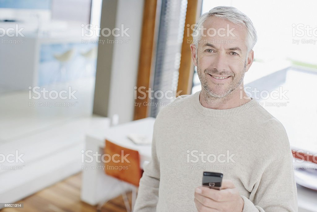 Man text messaging on cell phone royalty-free stock photo