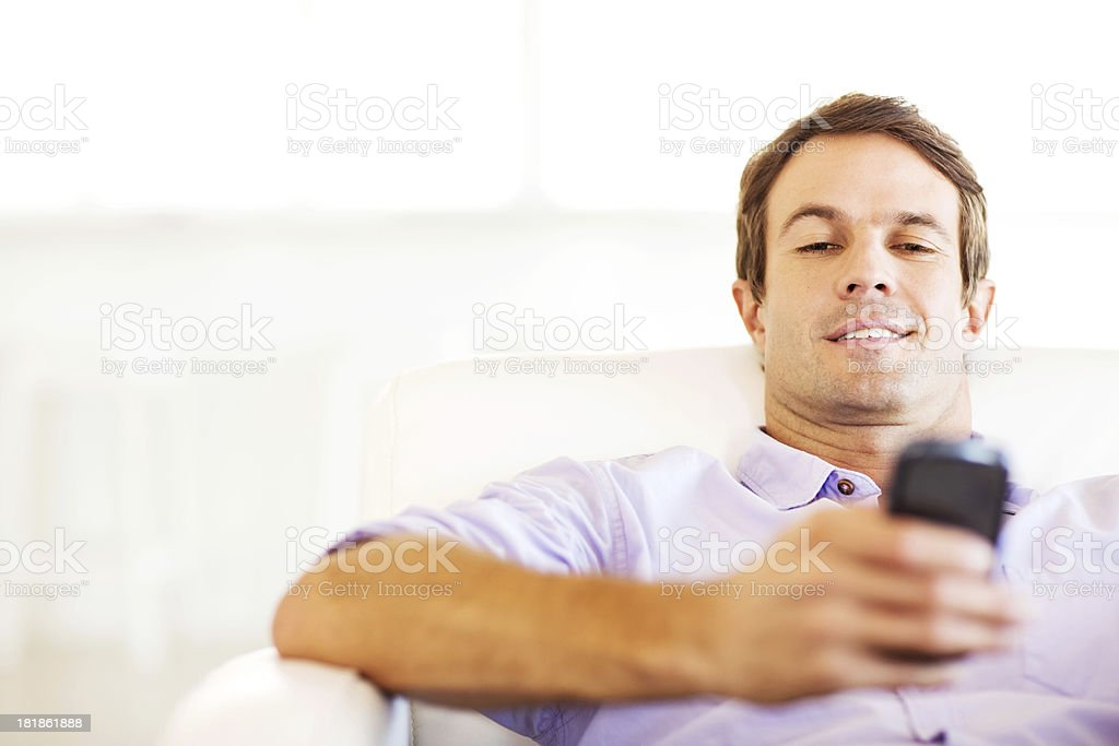 Man Text Messaging On Smart Phone At Home royalty-free stock photo
