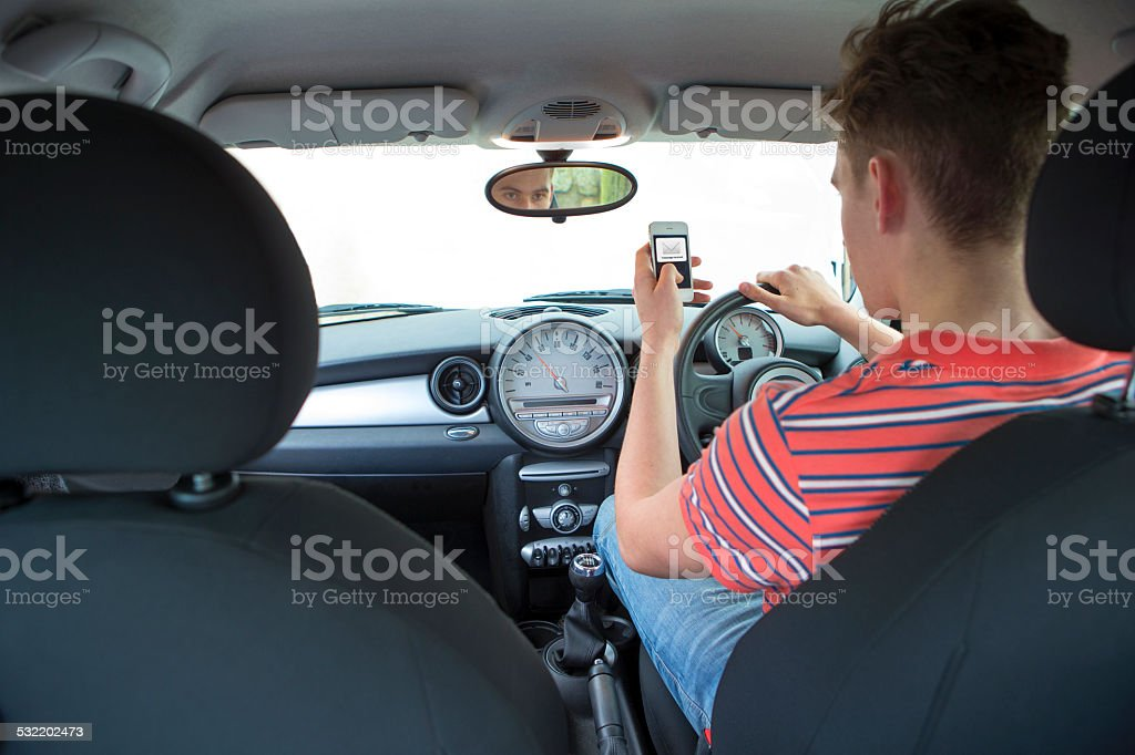 Man Text Messaging While Driving stock photo