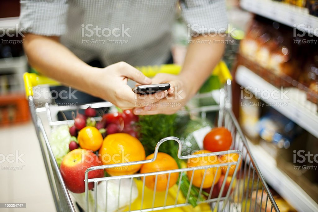 Man texting during shopping stock photo