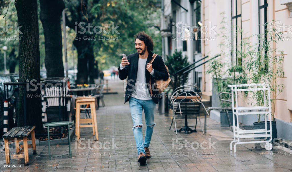 Man texting in the city royalty-free stock photo