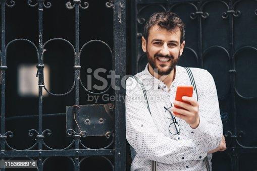 825083556istockphoto Man texting on phone 1153688916