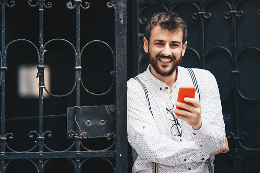 825083556 istock photo Man texting on phone 1153688916