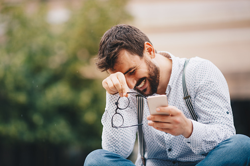 825083556 istock photo Man texting on phone 1154085471