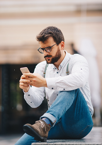 825083556 istock photo Man texting on phone 1154085472