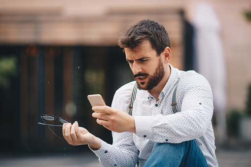 825083556 istock photo Man texting on phone 1154085526