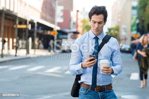 istock Man texting on phone 500838674