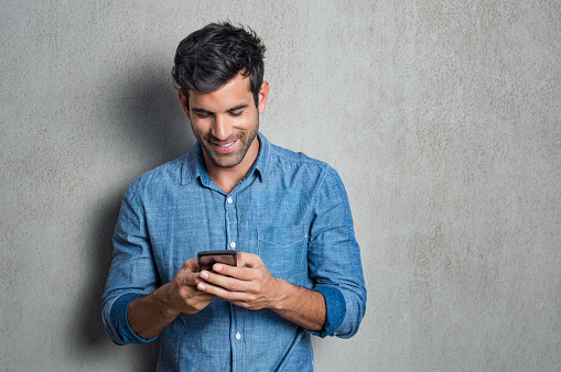 825083556 istock photo Man texting on phone 825083556