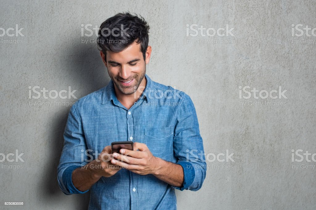 Man texting on phone stock photo